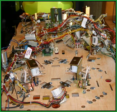 attaching a wiring harness to the pinball playfield